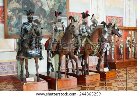 ST. PETERSBURG - JUNE 30, 2011: Knights mannequins on horses at Knights Hall of the Hermitage. It hosts a part of the Hermitage Arsenal collection. - stock photo