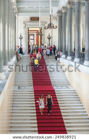 ST. PETERSBURG - JUNE 30, 2011: Unidentified tourists go down a staircase at the Hermitage. Over 3 million people visit the museum every year. - stock photo