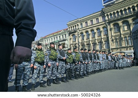 ST PETERSBURG - MAY 1: Police officers stand by during opposition protest rallies May 1, 2008 in St Petersburg, Russia. - stock photo