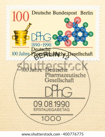 ST. PETERSBURG, RUSSIA - APR 4, 2016: A first day of issue postmark printed in Berlin, Germany, shows mortar and molecule, German Pharmaceutical Society, Cent., circa 1990 - stock photo