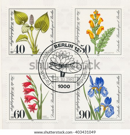 ST. PETERSBURG, RUSSIA - APR 10, 2016: A first day of issue postmark printed in Berlin, Germany, shows Common bistort, Pedicularis sceptrum-carolinum, Gladiolus palustris, Iris sibirica, circa 1981 - stock photo
