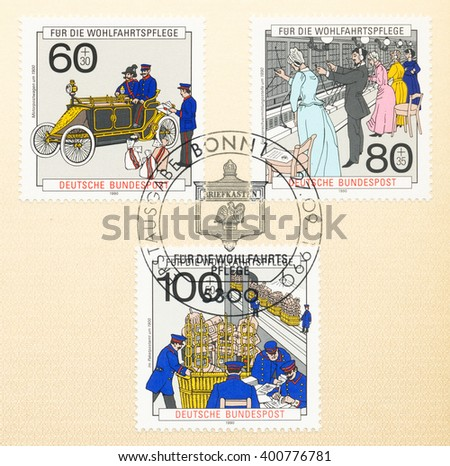ST. PETERSBURG, RUSSIA - APR 4, 2016: A first day of issue postmark printed in Bonn, Germany, shows Postal vehicle, Telephone exchange, Post office, circa 1990 - stock photo