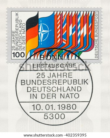 ST. PETERSBURG, RUSSIA - APR 7, 2016: A first day of issue postmark printed in Bonn, Germany, shows Flags of NATO and Members, Germanys membership in NATO, 25th anniv., circa 1980 - stock photo