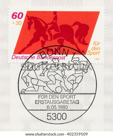 ST. PETERSBURG, RUSSIA - APR 7, 2016: A first day of issue postmark printed in Bonn, Germany, shows Equestrian and Soccer, circa 1980 - stock photo