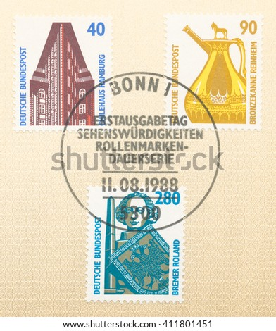 ST. PETERSBURG, RUSSIA - APR 25, 2016: A first day of issue postmark printed in Germany, shows Chile House, Hamburg. Bronze flagon from Reinheim. Statue of Roland, Bremen., circa 1988 - stock photo