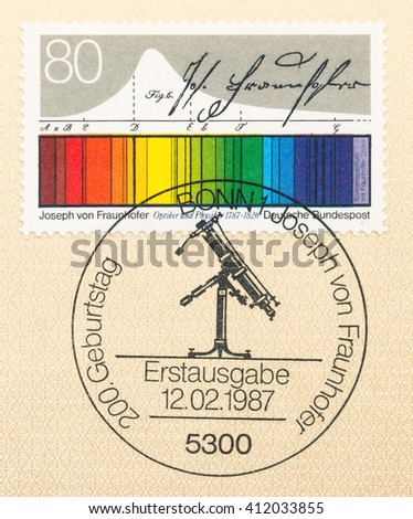 ST. PETERSBURG, RUSSIA - APR 27, 2016: A first day of issue postmark printed in Germany, shows Light spectrum diagram and telescope. Joseph von Fraunhofer (1787-1826), Optician, Physicist, circa 1987 - stock photo