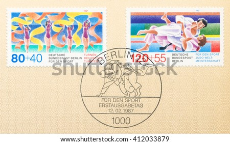 ST. PETERSBURG, RUSSIA - APR 27, 2016: A first day of issue postmark printed in Germany, shows Gymnastics and Judo, circa 1987 - stock photo