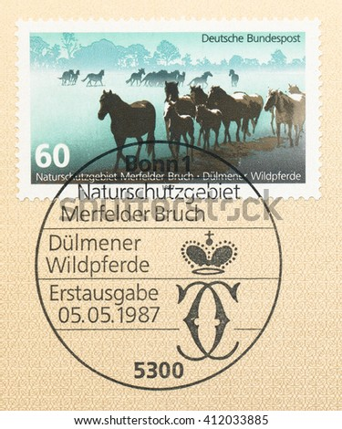 ST. PETERSBURG, RUSSIA - APR 27, 2016: A first day of issue postmark printed in Germany, shows Dulmens Wild Horses, Merfelder Bruch Nature Reserve. European Environmental Conservation Year, circa 1987 - stock photo