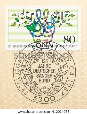 ST. PETERSBURG, RUSSIA - APR 27, 2016: A first day of issue postmark printed in Germany, shows notes, treble clef, leaves. German Choral Soc. 125th Anniv. , circa 1987 - stock photo