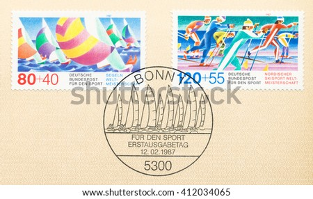 ST. PETERSBURG, RUSSIA - APR 27, 2016: A first day of issue postmark printed in Germany, shows World Championships: Sailing and Cross-country skiing, circa 1987 - stock photo