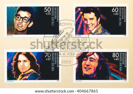 ST. PETERSBURG, RUSSIA - APR 12, 2016: A postmark Germany, shows Portraits Rock Stars: Buddy Holly (1936-59), Elvis Presley (1935-77), Jim Morrison (1943-71), John Lennon (1940-80), circa 1988 - stock photo