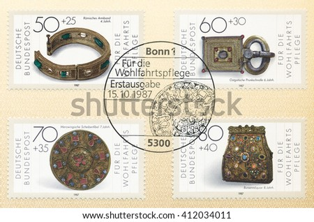 ST. PETERSBURG, RUSSIA - APR 27, 2016: A postmark Germany, shows Roman bracelet, 4th cent. Gothic buckle, 6th cent. Merovingian disk fibula, 7th cent. Purseshaped reliquary, 8th cent., circa 1987 - stock photo