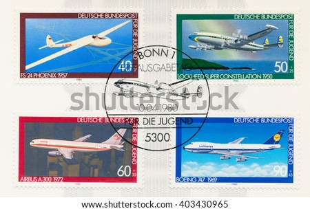 ST. PETERSBURG, RUSSIA - APR 8, 2016: A postmark printed in Berlin, Germany, shows FS 24 Phoenix 1957. Lockheed Super Constellation 1950. Airbus A300 1972. Boeing 747 1969, circa 1980 - stock photo