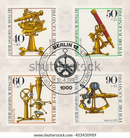 ST. PETERSBURG, RUSSIA - APR 10, 2016: A postmark printed in Berlin, Germany, shows Optical Instrument Type: Theodolite, 1810. Equatorial telescope, 1820. Microscope, 1790. Sextant, 1830, circa 1981 - stock photo
