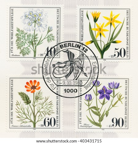 ST. PETERSBURG, RUSSIA - APR 8, 2016: A postmark printed in Berlin, Germany, shows Wildflowers: Orlaya, Yellow gagea, Summer pheasants eye, Small-flowered Venus looking-glass, circa 1980 - stock photo