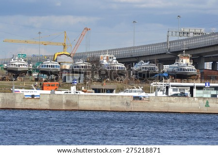 ST.PETERSBURG, RUSSIA - APRIL 25, 2015: Bank of the river Neva on the outskirts of St. Petersburg. River passenger hydrofoil repaired on the shore.