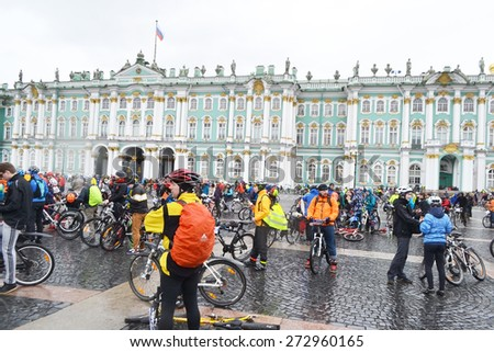 """ST.PETERSBURG, RUSSIA - APRIL 26, 2015: Bike Ride """"Opening the cycling season 2015"""". Finish cycling on Palace Square of St.Petersburg. - stock photo"""