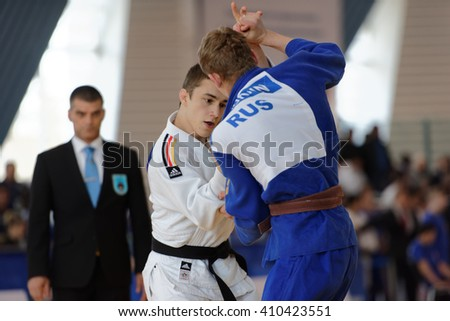 ST. PETERSBURG, RUSSIA - APRIL 16, 2016: Fight Leon Philipp of Germany vs Dmitry Karpukhin of Russia during the Junior European Judo Cup. 346 athletes from 22 countries participated in the competition - stock photo