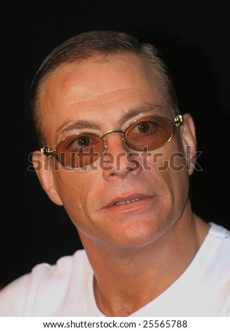 "ST. PETERSBURG, RUSSIA, APRIL 13, 2007: Film star Jean Claude Van Damme visited St-Petersburg and met with a world champion on ""mixed fight"" Fedor Emelianenko."