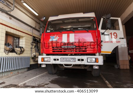 St. Petersburg, Russia - April 9, 2016: Front view of Kamaz 43253 truck. Modern Russian fire engine with open door stands in Fire Department garage - stock photo