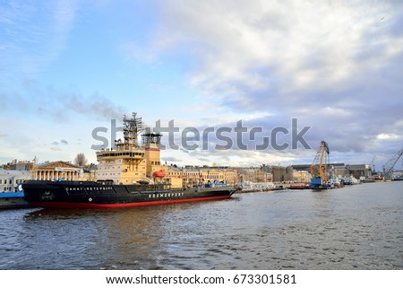 ST.PETERSBURG, RUSSIA - APRIL 30, 2017:  Icebreaker Saint Petersburg at sunset under the blue sky with clouds on the river Neva.