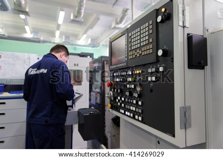 "ST. PETERSBURG, RUSSIA - APRIL 18, 2016: Man working in the Center of Fine Mechanics at JSC ""Avangard"". It is Russia's leading company in radio electronics and microsystems engineering"