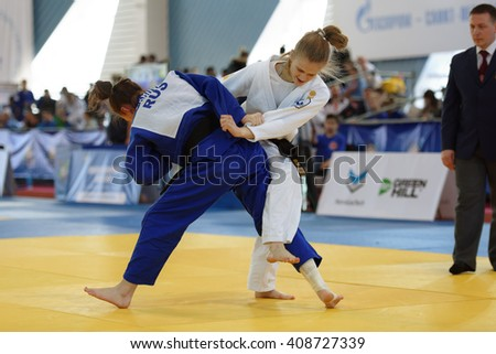 ST. PETERSBURG, RUSSIA - APRIL 16, 2016: Match Daria Pichkaleva (white) vs Aida Bikbova, both of Russia, during the Junior European Judo Cup. Athletes from 22 countries participated in the competition - stock photo