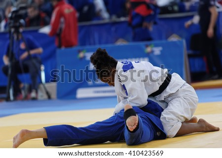 ST. PETERSBURG, RUSSIA - APRIL 16, 2016: Match Ulyana Minenkova of Belarus (blue) vs Sarah Leonie Cysique of France during the Junior European Judo Cup. 346 athletes participated in the competition - stock photo