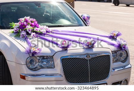 ST.PETERSBURG, RUSSIA - AUGUST 7, 2015: Beautiful flowers lay on the hood of wedding car - stock photo