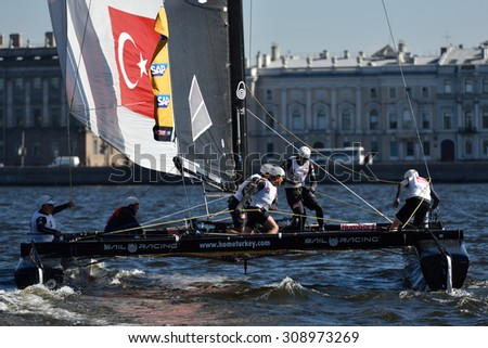 ST. PETERSBURG, RUSSIA - AUGUST 21, 2015: Catamaran of Team Turx of Turkey during 2nd day of St. Petersburg stage of Extreme Sailing Series. Red Bull Sailing Team of Austria leading after the 1st day - stock photo
