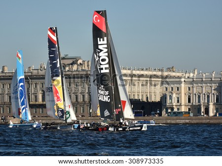 ST. PETERSBURG, RUSSIA - AUGUST 21, 2015: Extreme 40 catamarans during the 2nd day of St. Petersburg stage of Extreme Sailing Series. Red Bull Sailing Team of Austria leading after the 1st day - stock photo