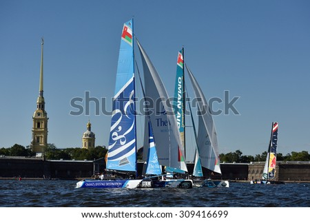 ST. PETERSBURG, RUSSIA - AUGUST 20, 2015: Extreme 40 catamarans during the 1st day of St. Petersburg stage of Extreme Sailing Series. Red Bull Sailing Team of Austria won the day with 58 points - stock photo