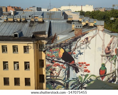 ST. PETERSBURG, RUSSIA - AUGUST 27: Tropical urban mural in old center of St Petersburg, Russia, on August 27, 2011. Courtyard of Ligovskiy prospect 72. - stock photo