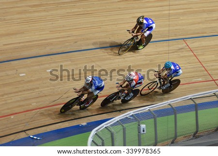 ST. PETERSBURG, RUSSIA - AUGUST 11, 2015: Unidentified riders compete in team race during Russian track cycling championship. Velodrome Lokosphinx hosts the competitions - stock photo