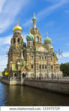 St. Petersburg, Russia, cathedral of Resurrection of Jesus Christ (Saviour on blood), unidentified people on the street. - stock photo