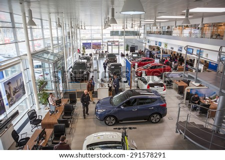 ST. PETERSBURG, RUSSIA - CIRCA APR, 2015: Top view of car dealership showroom with customers and salesmen. The Rolf Lahta is a official dealer of Hyundai company - stock photo