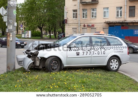 ST. PETERSBURG, RUSSIA - CIRCA MAY, 2015: Crashed taxi car is on pavement after frontal collision with pole. Accident with passing crossroads at a red light. No one injured. - stock photo