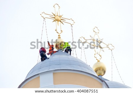 ST. PETERSBURG, RUSSIA - December 17, 2015:  Installation restored the crosses on the Prince St. Vladimir's Cathedral