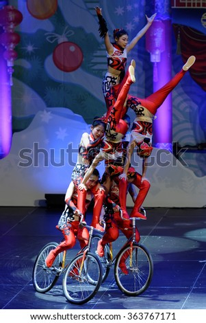 ST. PETERSBURG, RUSSIA - DECEMBER 26, 2015: Jinan acrobatic troupe performing in the Sibur Arena. Founded in 1958, this circus group is one of the best in China - stock photo