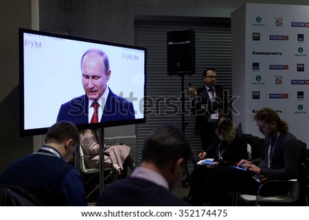 ST. PETERSBURG, RUSSIA - DECEMBER 14, 2015: Journalists work during the speech of President of Russia Vladimir Putin on the plenary meeting during 4th St. Petersburg International Cultural Forum - stock photo
