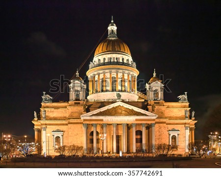 ST. PETERSBURG, RUSSIA - DECEMBER 25, 2015: Night view of St. Isaac's cathedral in winter. It is the largest orthodox basilica and the fourth largest cathedral in the world - stock photo