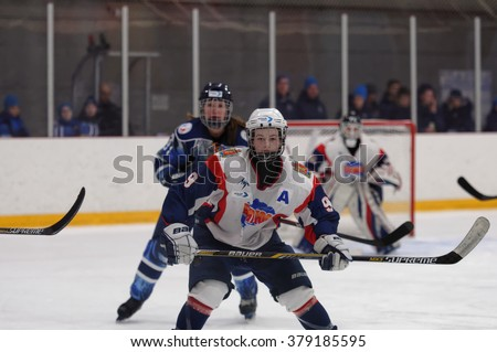 ST. PETERSBURG, RUSSIA - FEBRUARY 17, 2016: Women's ice hockey match Dinamo Saint-Petersburg vs Biryusa Krasnoyarsk. The teams fighting for 3rd place in Russian women's ice hockey championship - stock photo