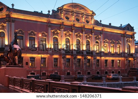 ST. PETERSBURG, RUSSIA - JANUARY 17: Belosselsky-Belozersky Palace and Anichkov Bridge in St. Petersburg on January 17, 2013. The palace is under restoration till October 2013 after the fire of 2012 - stock photo