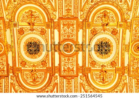 ST PETERSBURG, RUSSIA - JANUARY 25, 2015:State Hermitage is museum of art and culture. One of oldest museums in world, it was founded in 1764 by Catherine Great. Vaulted ceiling of Gold Drawing Room  - stock photo