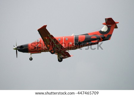 "ST. PETERSBURG, RUSSIA - JULY 03, 2016: Aircraft Pilatus PC-12/47E (RA-01505) Russian air taxi ""Dexter"" on the background of cloudy sky"
