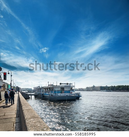 ST. PETERSBURG, RUSSIA - JULY 11, 2016: Embankment of the river Neva and a pier in front of St. Isaac's Cathedral, St. Petersburg, Russia.