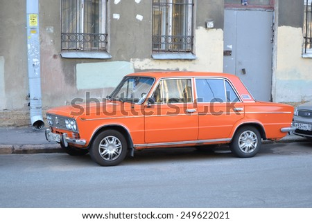 ST.PETERSBURG, RUSSIA - JULY 29, 2012: Old orange VAZ-2106 Zhiguli classic soviet vehicle at the city street. - stock photo