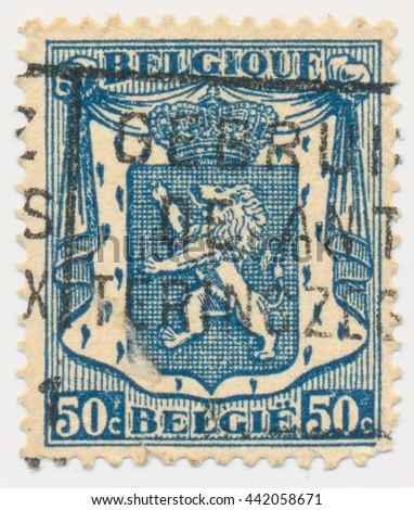 ST. PETERSBURG, RUSSIA - JUNE 23, 2016: A postmark printed in BELGIUM, shows Heraldic Lion on mantle, circa 1936 - stock photo