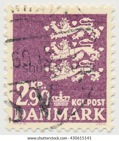 ST. PETERSBURG, RUSSIA - JUNE 1, 2016: A postmark printed in Denmark, shows  Par value 2.9 and three lions - detail of the national coat of arms of Denmark, circa 1968
