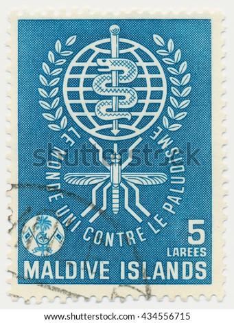 ST. PETERSBURG, RUSSIA - JUNE 8, 2016: A postmark printed in MALDIVE ISLANDS, shows Malaria Eradication Emblem, circa 1961 - stock photo